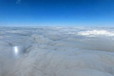 Als Entschädigung für das lange Warten gibt es Sonnenschein über den Wolken. Foto: Birgit Wehner/TROPOS