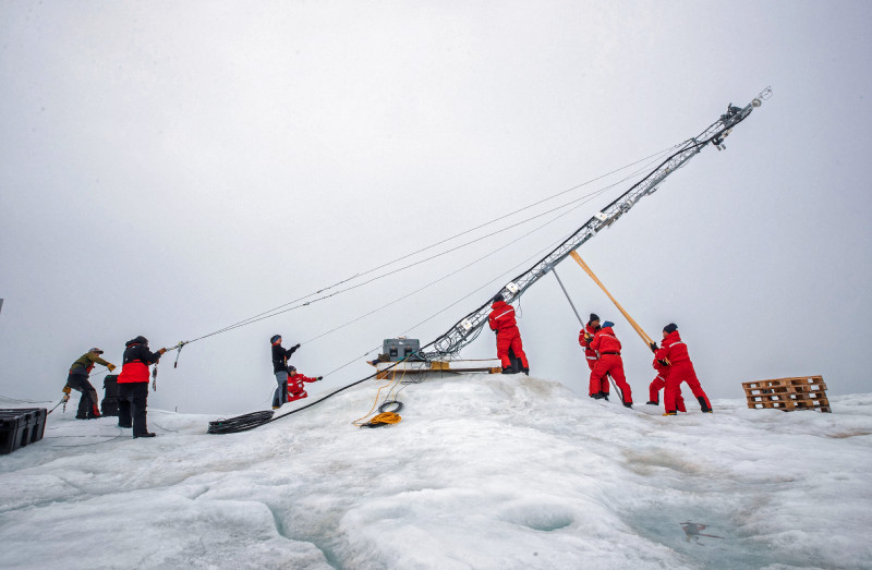 Lowering a tower in Met City, which has been picked with sensors to study atmosphere-seaice interactions. Photo: Lianna Nixon, University of Colorado