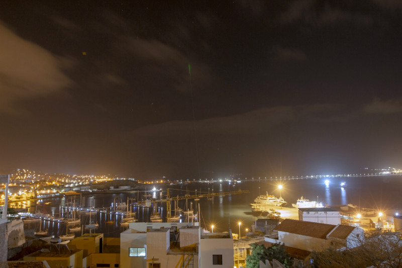 The green lasers of the two lidars from NOA and TROPOS can be seen far beyond the harbour at night. Photo: Edson Silva Delgado, Etfilmes / OSCM